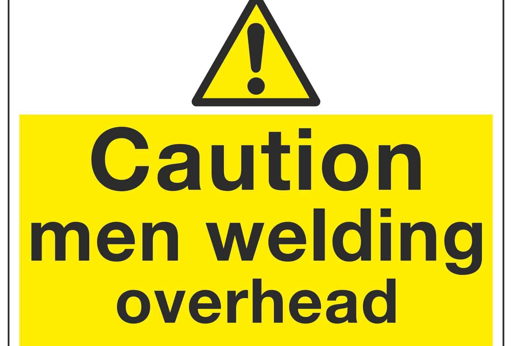 Caution men welding overhead