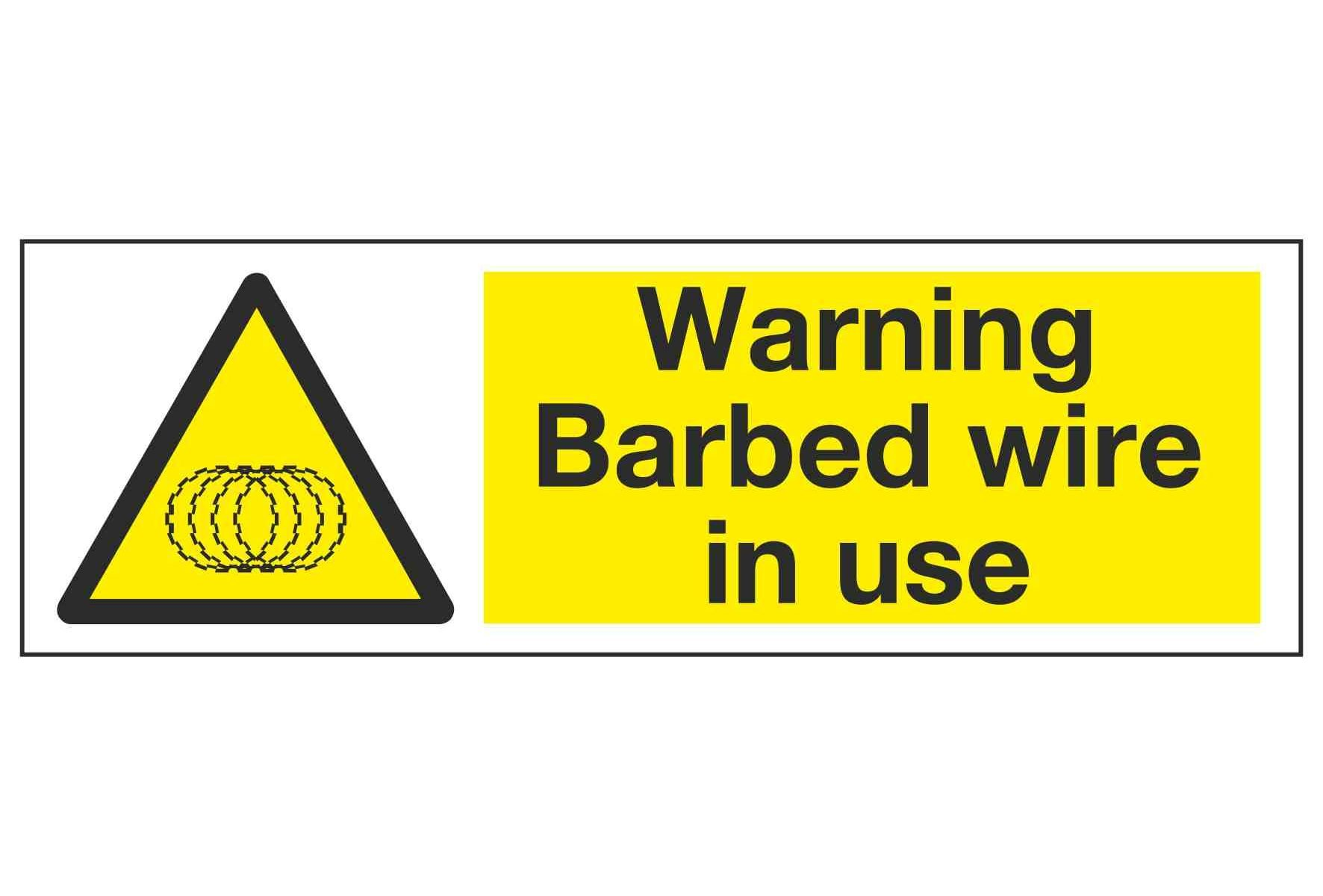 Warning Barbed wire in use